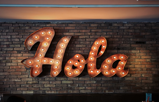 hola written in a sign with lights