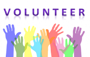 Volunteer written above multicolored raised hands