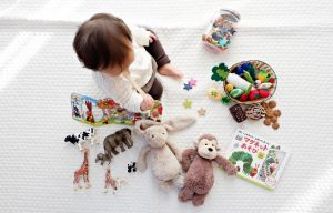 toddler surrounded by toys