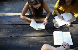 teens reading at a table
