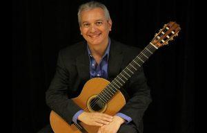 Francisco Roldan holding guitar