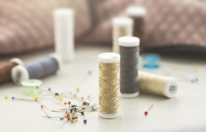 sewing spools and needles