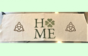 Celtic and Irish symbols and the word home on a table runner