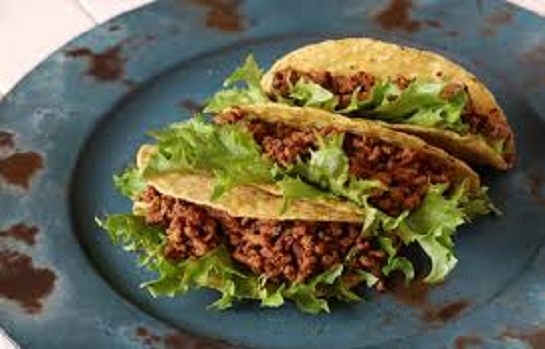 multiple tacos with meet and lettuce