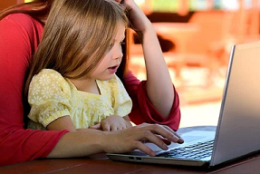 Child and Parent on Computer