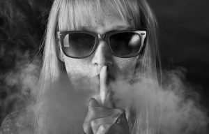 Art Photo woman in glasses with finger in front of face