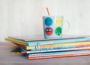 Stack of children books with mug on top